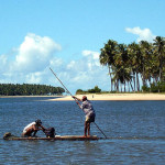 Fishermen at freshwater stream near Tamandare, PE, Brazil