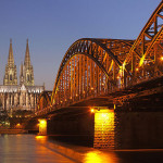 Hohenzollernbrücke in Cologne (Germany) with Cologne Cathedral in the blue hour.