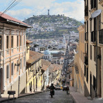 Quito, capital of Ecuador, Garcia Moreno street in the historic center of the city. The Virgin of Quito is seen in the background.