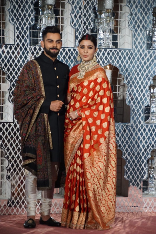 Virat Kohli Wedding.Virat Kohli Anushka Sharma Wedding Reception Photos